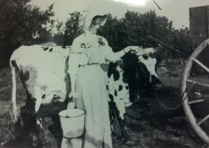 "Francis Probstfield, wife of Arthur Probstfield, poses with ""The Family Milk Supply.""  Taken about 1910."
